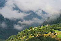 IFTE-NB-007925; Niall Benvie; Cut hay meadows near Fliess; Austria; Europe; Austria; Tirol; clouds mist hut building hay barn fields; horizontal; high above steep; green; farmland grassland meadow; 2008; July; summer; mist; agriculture; Wild Wonders of Europe Naturpark Kaunergrat