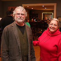 Dennis Walsak, left and Posey Walsak pose for a picture Sunday December 21, 2014 during the Brooklyn Arts District Christmas party at Canape in Wilmington, N.C. (Jason A. Frizzelle)
