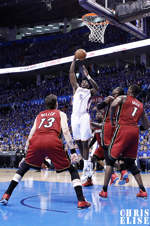 12 June 2012: Oklahoma City Thunder center Kendrick Perkins (5) goes for the skyhook during the second half of Game 1 of the 2012 NBA Finals between the Heat and the Thunder, at the Chesapeake Energy Arena, Oklahoma City, Oklahoma, USA.