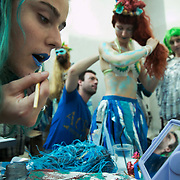 Bp-or-not-BP stage a splash mob art intervention at the British Museum in protest against the continued BP sponsorship of the exhibition 'Sunken Cities' 25th of September 2016. Merfolk actors are getting ready in the Museum cafe. A flock of merfolk and BP pirates roamed the museum as well as a kraken, a giant sea monster.