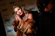 A model gets ready for the catwalk at the Millionaire Fair in Moscow. .Millionaires, billionaires and those who bought 1,000-rouble tickets were among the thousands who visited the fair held in the Crocus city expo centre. .The four-day event, held for the second year in a row, ended on October 30. The products on sale include a diamond-studded mobile phone worth a million dollars, an island, latest sports cars and other items that might appeal to the growing millionaire market..Twenty years ago, there were no official millionaires in the whole of Russia. Now Moscow has 25 billionaires and the country has 88,000 millionaires, according to Forbes Magazine. ..