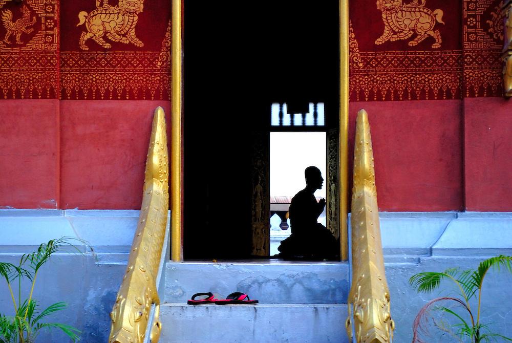Silhouette of praying monk