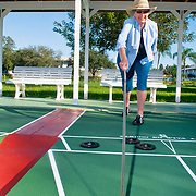 An 83-year-old woman enjoys a morning game of shuffleboard in Tequesta, FL.