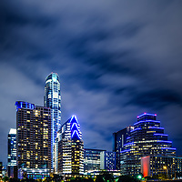 Blue Austin skyline at night along the colorado river in the Southwestern United States of America. Photo was taken in 2016.