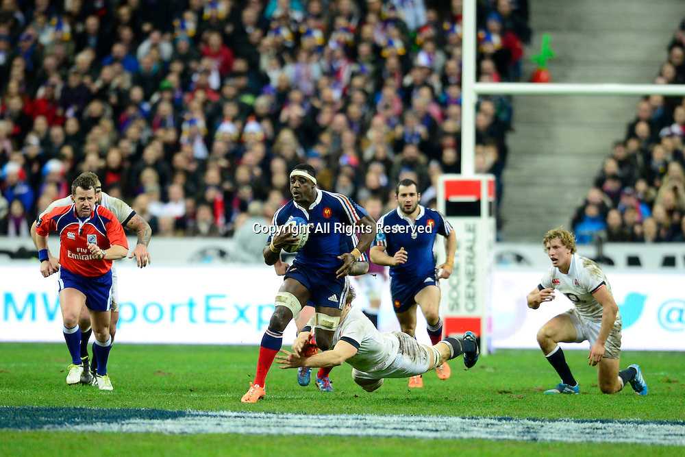01.02.2014. Stade de France, Paris, France. 6 Nations International Rugby Union. France versus England.  Yannick Nyanga ( France ) breaks to midfield despite the flying tackle