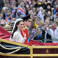 Prince William and Katherine Middleton make their way to Buckingham Palace following their wedding ceremony.