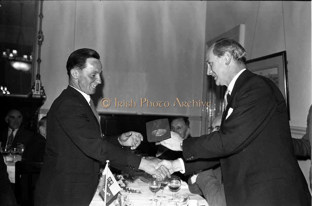 03/07/1963<br /> 07/03/1963<br /> 03 July 1963<br /> David Brown Tractor and Implements Maintenance Awards presented by Minister of Industry and Commerce Jack Lynch TD at the Shelbourne Hotel, Dublin. Picture shows Jack Lynch (right) presenting one of the runners up awards.