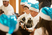 Members of the Alisal Center for the Fine Arts Rondalla Guitar Ensemble perform at the December 5th, 2017 opening of the Stories from Salinas exhibition at the CSUMB Salinas Center for Arts and Culture in Oldtown. The exhibition celebrates the mentors, youth and families of the Salinas Youth Initiative.