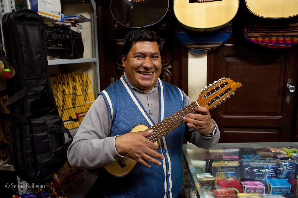 A man playing a charango in La Paz, Bolivia.  A Charango is a 12 string instrument made from armadillo shell and wood and is played throughout the Andes.