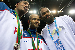 Boris Diaw of France, Tony Parker of France and Ronny Turiaf of France at medal ceremony after the final basketball game between National basketball teams of Spain and France at FIBA Europe Eurobasket Lithuania 2011, on September 18, 2011, in Arena Zalgirio, Kaunas, Lithuania. Spain defeated France 98-85 and became European Champion 2011, France placed second and Russia third. (Photo by Vid Ponikvar / Sportida)