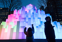 © Licensed to London News Pictures. 18/01/2020. LONDON, UK. Young visitors interact with Mountain of Light by Angus Muir Design at the sixth Winter Lights festival in Canary Wharf.  25 light art and interactive installations by international artists are on display for the public to enjoy until 25 January 2020.  Photo credit: Stephen Chung/LNP