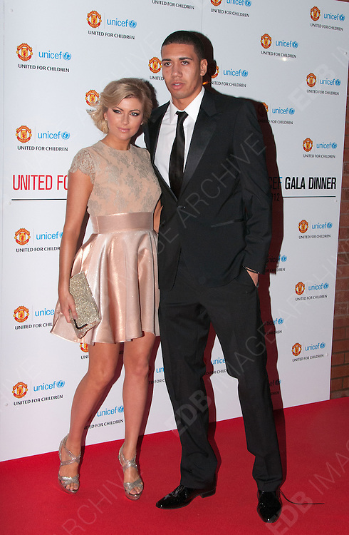 19.DECEMBER.2012. MANCHESTER<br /> <br /> CHRIS SMALLING AND GIRLFRIEND SAM COOKE ATTEND THE MANCHESTER UNITED FOOTBALL CLUB UNICEF GALA DINNER HELD AT THE OLD TRAFFORD STADIUM IN MANCHESTER.<br /> <br /> BYLINE: EDBIMAGEARCHIVE.CO.UK<br /> <br /> *THIS IMAGE IS STRICTLY FOR UK NEWSPAPERS AND MAGAZINES ONLY*<br /> *FOR WORLD WIDE SALES AND WEB USE PLEASE CONTACT EDBIMAGEARCHIVE - 0208 954 5968*
