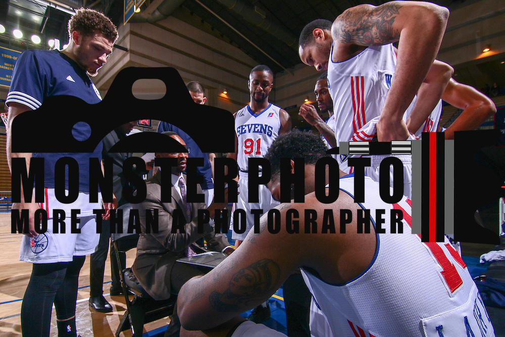 Delaware 87ers Head Coach EUGENE BURROUGHS, CENTER, huddles with his team during a time out in the first half of a NBA D-league regular season basketball game between the Delaware 87ers and the Grand Rapids Drive (Detroit Pistons) Tuesday. Nov. 29, 2016 at The Bob Carpenter Sports Convocation Center in Newark, DEL.