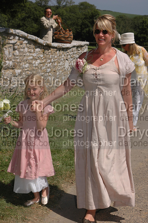 Molly Fox and Mrs. Robert Fox. Marriage of Emilia Fox to Jared Harris. St. Michael's and All Angels. Steeple. Nr. Wareham. Dorset. 16 July 2005. ONE TIME USE ONLY - DO NOT ARCHIVE  © Copyright Photograph by Dafydd Jones 66 Stockwell Park Rd. London SW9 0DA Tel 020 7733 0108 www.dafjones.com