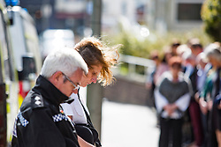 © Licensed to London News Pictures. 10/04/2017. Brighton, UK. Members of the Brighton and Hove police department hold a 2 minute silence outside the Brighton John Street police station in remembrance of PC Keith Palmer who died during the Westminster attack. Photo credit: Hugo Michiels/LNP