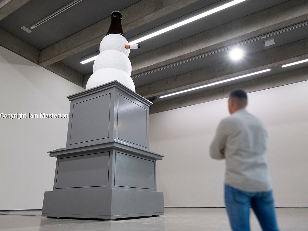 """Edinburgh, Scotland, UK. 21 November, 2018. The historic City Observatory on Calton Hill will reopen as The Collective, an arts organisation and will feature the restored City Observatory, City Dome, and a purpose-built exhibition space. It opens to the public on 24 November, 2018. Pictured; Art work by Klaus Weber titled, Fagman, in the Hillside space. Conceived as a """"Nonument"""" to sit at a corner of the Collective, the smoking snowman sculpture with bottle top hat is an antihero countering the historic monuments at Calton Hill."""