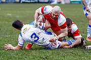 Keighley Cougars centre Adam Ryder (4) rips the ball from Workington Town centre Scott Akehurst (3)  during the Betfred League 1 match between Keighley Cougars and Workington Town at Cougar Park, Keighley, United Kingdom on 18 February 2018. Picture by Simon Davies.