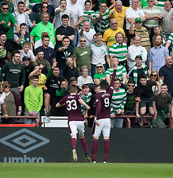 Hearts Kyle Lafferty celebrates scoring his side's first goal of the game during the Ladbrokes Scottish Premiership match at Tynecastle Stadium, Edinburgh. ***Editors note gestures in crowd***