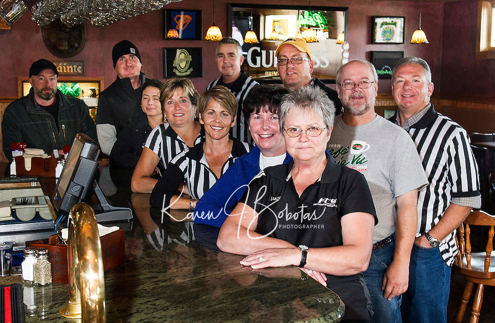 "Returning team members and the ""official"" referrees get prepped for the Pub Mania event at Patrick's Pub and Eatery to benefit the Children's Auction to begin on December 8th.  (l-r Keith McBey, Matt Resca, Ashley Riopel, Allan Beetle, Jennifer Bailey, Jennifer Beetle, Randy Remick, Marcia Wadsworth, Tony Felch, Shawn Bailey and Lucy Jacobson).  (Karen Bobotas/for the Laconia Daily Sun)"