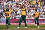 Matthew Carter and Tom Moores of Notts Outlaws celebrates the wicket of Moeen Ali during the Vitality T20 Finals Day 2019 match between Notts Outlaws and Worcestershire Rapids at Edgbaston, Birmingham, United Kingdom on 21 September 2019.