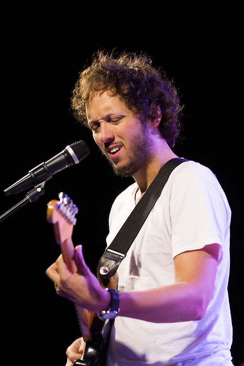 Michael Gungor concentrates on his solo during a performance at the 2012 Wild Goose West festival in Corvalis, Or.