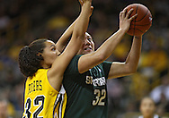 January 27 2010: Iowa forward Jade Rogers (32) puts up a shot as Iowa forward Jade Rogers (32) defends during the second half of an NCAA women's college basketball game at Carver-Hawkeye Arena in Iowa City, Iowa on January 27, 2010. Iowa defeated Michigan State 66-64.