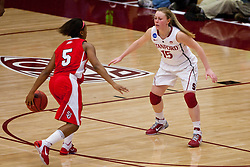 March 21, 2011; Stanford, CA, USA; St. John's Red Storm guard Nadirah McKenith (5) is defended by Stanford Cardinal guard Lindy La Rocque (15) during the first half of the second round of the 2011 NCAA women's basketball tournament at Maples Pavilion. Stanford defeated St. John's 75-49.