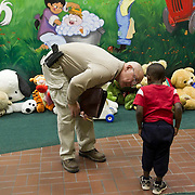 Terry Bose, a Phoenix Police detective (family investigations Bureau Crimes against Children Unit) looks at the bruises injuries to a boy at Childhelp  Children's Center in Phoenix. Police, CPS, medical personnel and therapists work together at the family advocacy center on child abuse and neglect cases. This boy's father is accused of beating him and his four siblings.
