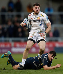 Exeter Chiefs' Alex Cuthbert (top) avoids a tackle from Sale Sharks Rob Webber during the Gallagher Premiership match at the AJ Bell Stadium, Salford.