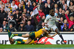 England Winger (#11) Marland Yarde (London Irish)  is tackled short of the tryline during the second half of the match - Photo mandatory by-line: Rogan Thomson/JMP - Tel: Mobile: 07966 386802 02/11/2013 - SPORT - RUGBY UNION -  Twickenham Stadium, London - England v Australia - Cook Cup - QBE Autumn Internationals.