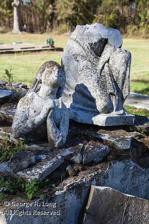 broken statue of woman praying in St. Raphael Cemetery along River Road south of Plaquemine, Louisiana