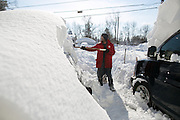 DAVE MORRIS shovels snow from atop his car in Alden, New York, USA on Wednesday, November 19, 2014. Up to six feet of snow fell on the region Tuesday, stranding dozens of motorists on roadways and causing at least six deaths.