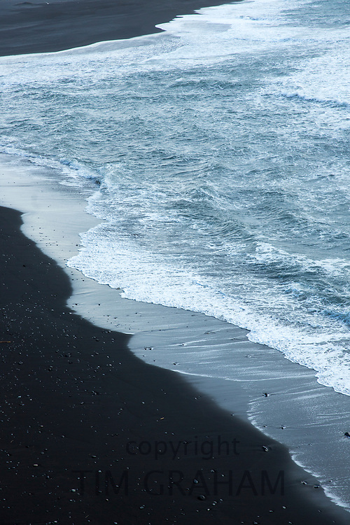 Black volcanic sand beach Reynisfjara with dangerous tides near the village Vík i Myrdal, South Iceland