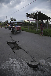 December 10, 2016 - Merudeu, Aceh, Indonesia - Aceh, Pidie, Indonesia, 10 December 2016 : Situation after math of earth quake at Pidie-Aceh. Some road heavy damage, Indonesian search and rescue team still working on finding the victim of the earth quake, and ruined houses after the earth quake. Aceh hit with 6.5 magnitude earth quake that killed almost 100 people, Indonesian government applied the 14th days emergency situation since the first disaster happening. (Credit Image: © Donal Husni via ZUMA Wire)
