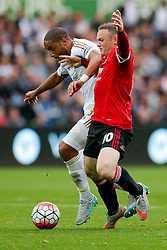 Wayne Rooney of Manchester United goes down inside the penalty area under a challenge from Ashley Williams of Swansea City - Mandatory byline: Rogan Thomson/JMP - 07966 386802 - 30/08/2015 - FOOTBALL - Liberty Stadium - Swansea, Wales - Swansea City v Manchester United - Barclays Premier League.