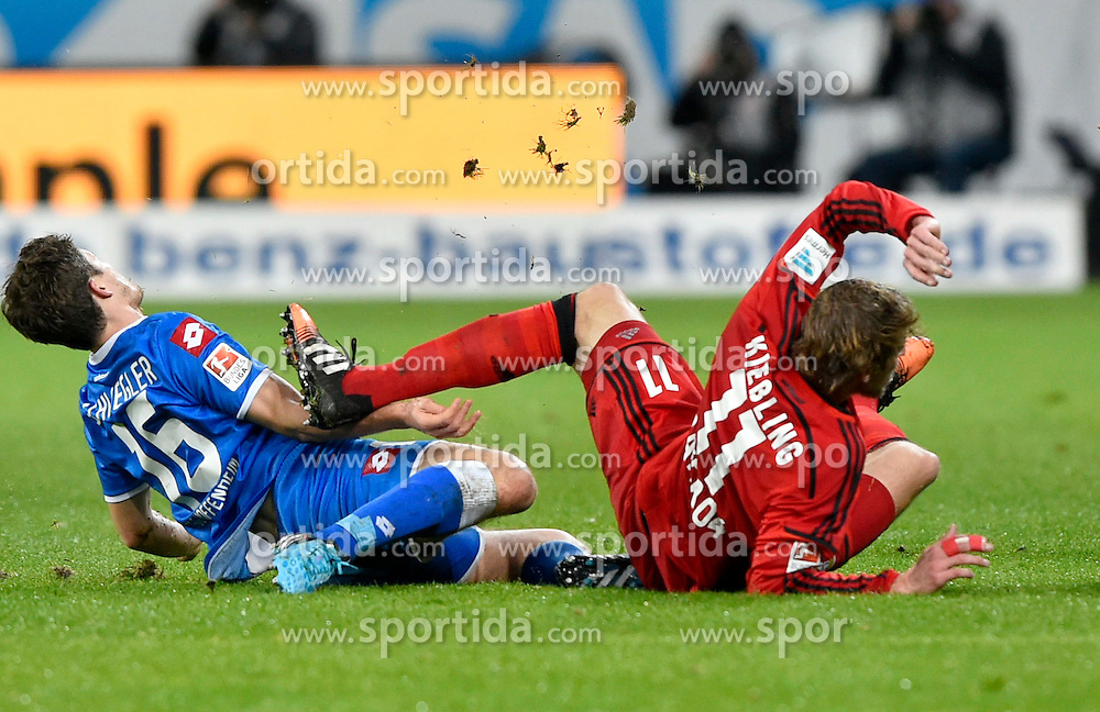 17.12.2014, Rhein Neckar Arena, Sinsheim, GER, 1. FBL, TSG 1899 Hoffenheim vs Bayer 04 Leverkusen, 16. Runde, im Bild Zweikampf Aktion Pirmin Schwegler TSG 1899 Hoffenheim (links) gegen Stefan Kiessling Bayer 04 Leverkusen (rechts) trifft ihn am Arm // during the German Bundesliga 16th round match between TSG 1899 Hoffenheim and Bayer 04 Leverkusen at the Rhein Neckar Arena in Sinsheim, Germany on 2014/12/17. EXPA Pictures &copy; 2014, PhotoCredit: EXPA/ Eibner-Pressefoto/ Weber<br /> <br /> *****ATTENTION - OUT of GER*****