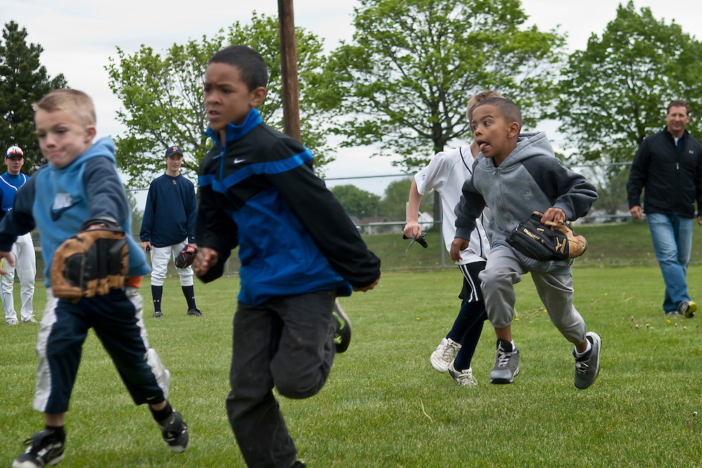 Lathan Goumas | MLive.com..May 5, 2012 - Kids run during a Pitch, Hit & Run sponsored by the Boys & Girls Club of Greater Flint on Saturday at Broome Park in Flint, Mich.