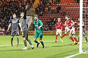 As Crewe players celebrates the goal from 8 James Jones, Lincoln players protest to the assistant for offside during the EFL Sky Bet League 2 match between Crewe Alexandra and Lincoln City at Alexandra Stadium, Crewe, England on 26 December 2018.