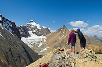 Hikers admiring view from summit of Parker Ridge, Mount Atahbasca is in the distance, Banff National Park Alberta Canada