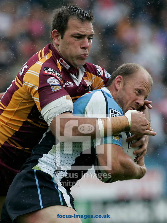 Huddersfield - Sunday, June 22nd, 2008: Harlequin's Danny Orr in action against Huddersfield's John Skandalis during the Engage Super League match at the Galpharm Stadium, Huddersfield. (Pic by Michael Sedgwick/Focus Images)