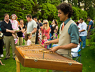 Old Westbury, New York, U.S. 22nd June 2013. Musician MAX ZBIRAL-TELLER is playing a hammered dulcimer at the Midsummer Night event at Old Westbury Gardens, with dances performed throughout the illuminated grounds of the historic Long Island Gold Coast estate.