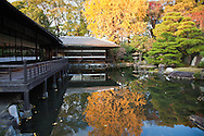 "Teahouse at the pond garden of Shosei-en - Rinchi-tei on the left and Tekisui-ken to its right. Shosei-en Garden was designed as a retreat for the chief priest Sen'nyo.  Shosei-en is also called Kikoku-tei ""Orange Mansion"" because it was once surrounded by orange groves. The garden is a Chisen Kaiyu Shiki teien, that is, a pond strolling garden with buildings such as tea-ceremony houses arranged throughout the grounds."
