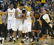 Dec 19, 2013; Long Beach, CA, USA; Long Beach State players Daniel Samuels (11), Tyler Lamb (1) and Mike Caffey (5) celebrate at the end of the game as Southern California Trojans guard Byron Wesley (22) reacts at Walter Pyramid. Long Beach State defeated USC 72-71.