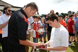 Bristol City manager, Steve Cotterill signs an autograph for a fan as Bristol City play a Community match against Brislington and Keynsham Town - Photo mandatory by-line: Dougie Allward/JMP - Mobile: 07966 386802 - 05/07/2015 - SPORT - Football - Bristol - Brislington Stadium - Pre-Season Friendly