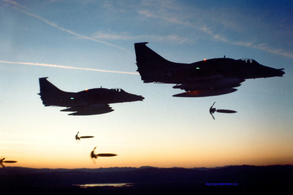 A-4M Skyhawks dropping Mark 82s with retarders