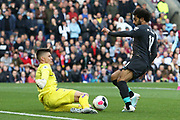 Burnley goalkeeper Nick Pope (1) blocks the shot from Liverpool forward Mohamed Salah (11) during the Premier League match between Burnley and Liverpool at Turf Moor, Burnley, England on 31 August 2019.