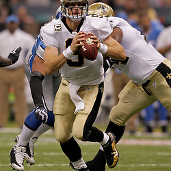 2009 September 13: New Orleans Saints quarterback Drew Brees (9) looks to throw during a 45-27 win by the New Orleans Saints over the Detroit Lions at the Louisiana Superdome in New Orleans, Louisiana.