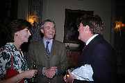 Fiona Stourton, Andrew Mitchell ( newly elected MP) and Edward Stourton. Book party to celebrate the publication of ' How the King of Scots Won the Throne of England in 1603 by Leanda de Lisle. St. Wilfred's Hall. Brompton Oratory. London. 9 May 2005. ONE TIME USE ONLY - DO NOT ARCHIVE  © Copyright Photograph by Dafydd Jones 66 Stockwell Park Rd. London SW9 0DA Tel 020 7733 0108 www.dafjones.com