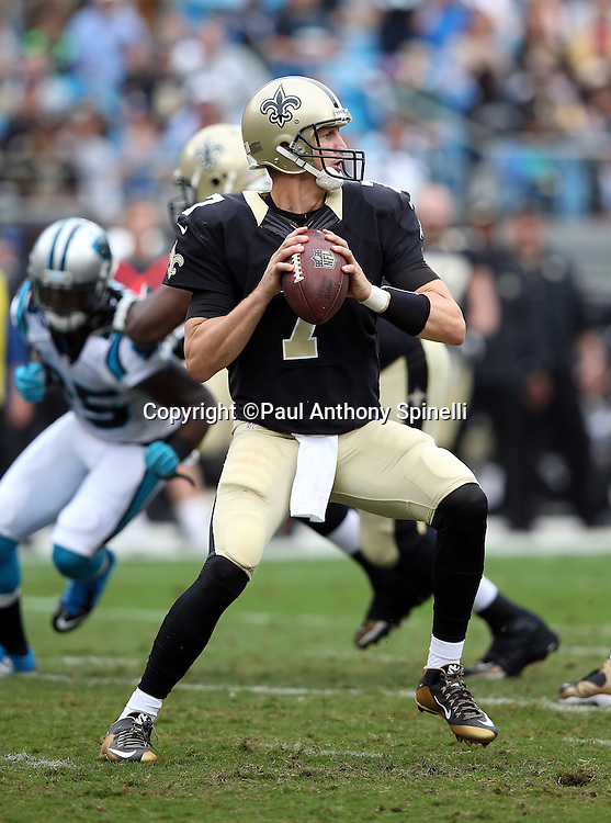 New Orleans Saints quarterback Luke McCown (7) throws a first quarter pass for a first down during the 2015 NFL week 3 regular season football game against the Carolina Panthers on Sunday, Sept. 27, 2015 in Charlotte, N.C. The Panthers won the game 27-22. (©Paul Anthony Spinelli)