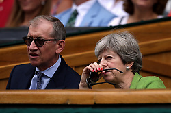 Theresa and Philip May in the royal box of centre court on day thirteen of the Wimbledon Championships at The All England Lawn Tennis and Croquet Club, Wimbledon.